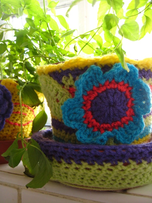 Yarn-bombed flower pot