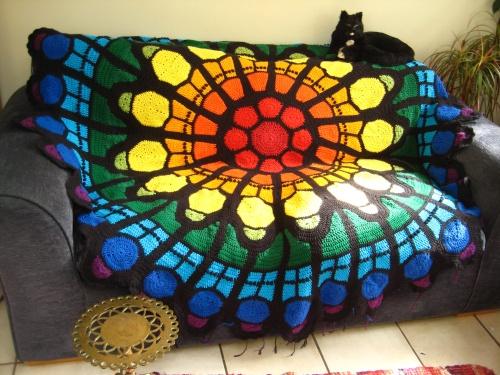 Big afghan covers fugly sofa