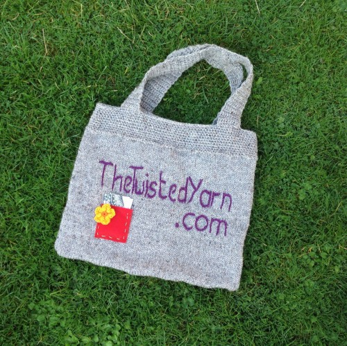 The bag. Embroidery imperfect owing to extreme haste of sewing.