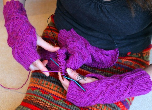 No I don't really hold my needles like this, but it's tricky to photograph yourself knitting, I discover... Oh, and don't look closely at the gloves because they haven't been blocked yet.